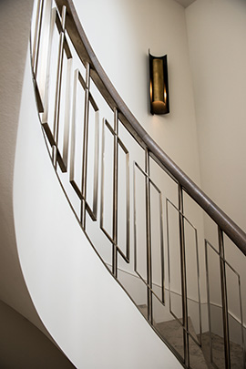 Showing the curved sweep of the staircase with balustrades in Almond Gold stainless steel