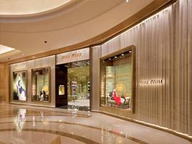 Exterior cladding to Miu Miu store interior in PVD Champagne Brush