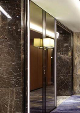 Call Button panel in V-grooved and folded Bronze PVD stainless steel in the Shangri La Hotel at the Shard, London
