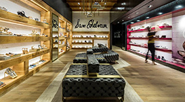 The seating back brass panels were laser cut and V-Grooved to create a return of 1/4inch depth for this Sam Edelman Californian shoe store by our US VGrooving partner Niconat.