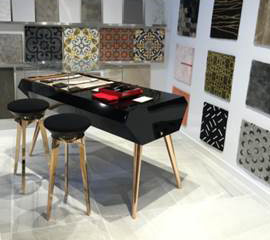 Showcase Desk for glass showroom in V-Grooved and folded metal with complementary V-Grooved stool legs. By our US V-Grooving partner, Niconat.