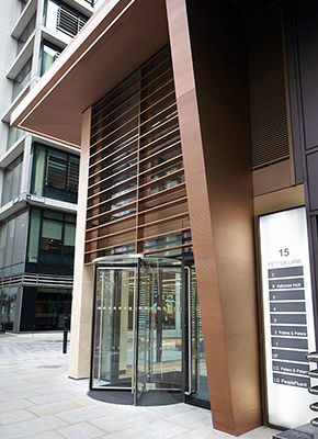 15 Fetter Lane, EC4A, London Brise Soleil, column and canopy in Chocolate PVD stainless steel V-Grooved and folded to appear as solid bronze.