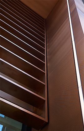 15 Fetter Lane, EC4A, London. - Brise soleil, canopy and column from V-grooved PVD stainless steel.