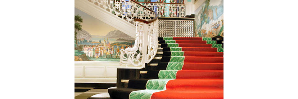 The main staircase in the Greenbrier Hotel, White Sulphur Springs, West Virginia with Dorothy Draper's typically bold black, orange and green décor.
