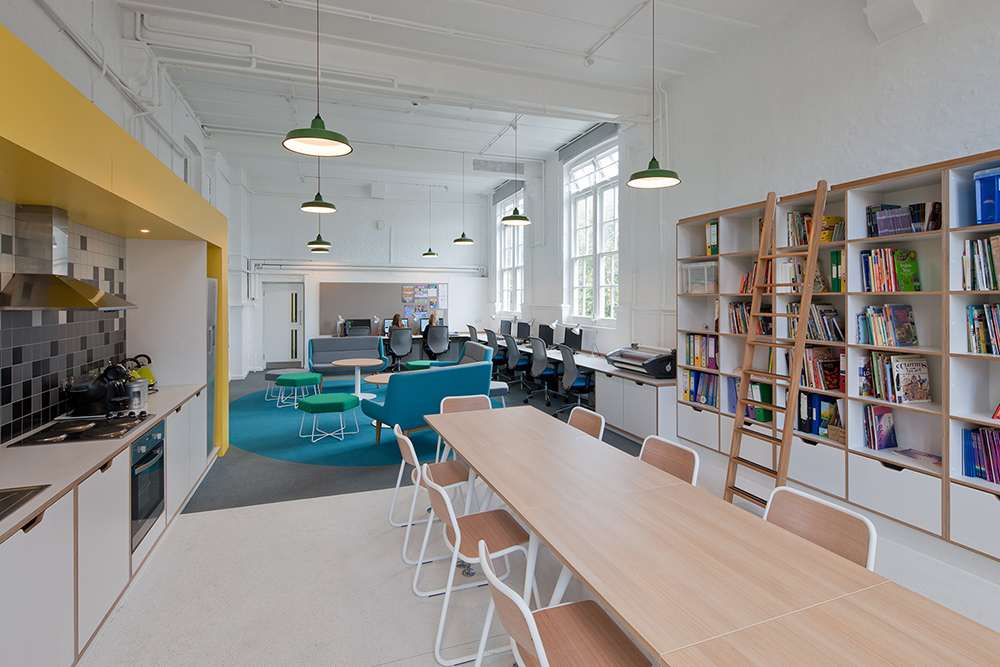 We designed the staff room at The Charles Dickens Primary School to improve the collaboration between teachers. Previously, they stored all curriculum materials in a small cupboard, but we put this on show, situated within the staff dining space. The old curriculum store was then transformed into a silent marking room. - Interior design by Contents Design